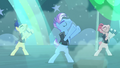 Backup dancers on the left moving their arms to their left S5E24.png