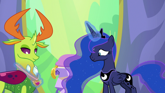 File:Luna fits Thorax's medal around his neck S7E1.png