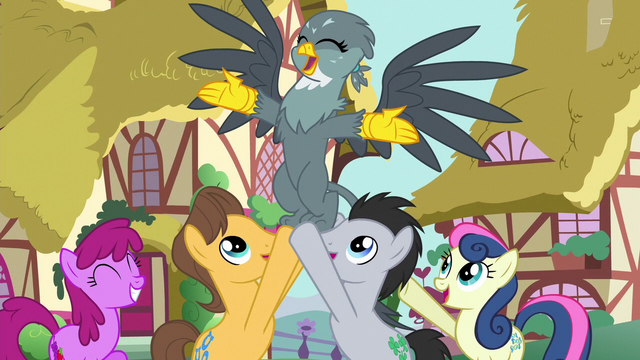 File:Ponyville ponies holding up Gabby S6E19.png