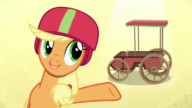 File:Applejack presenting her Derby cart S6E14.png