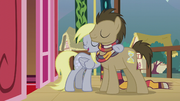 Derpy puts a hoof around Dr. Hooves S5E9.png