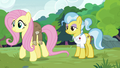 Fluttershy carries Lola the sloth to the tree S7E5.png