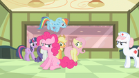 Nurse Redheart throwing out Pinkie S2E13