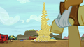 Braeburn looks at giant stack of hay bales S5E6.png