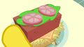 Brick in Mr. Cake's hay burger S6E15.png