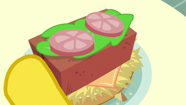 File:Brick in Mr. Cake's hay burger S6E15.png