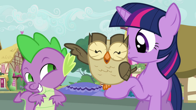 File:Owlowiscious swats Spike with his wing S03E11.png