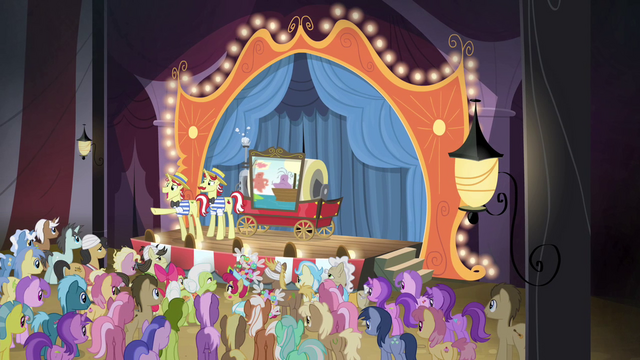 File:Flim pointing at the audience S4E20.png
