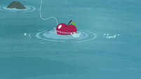 Apple bait being thrown onto the water S4E20