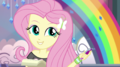 Fluttershy holding a pen EGS1.png