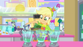 Applejack pouring milk in the blenders SS9.png
