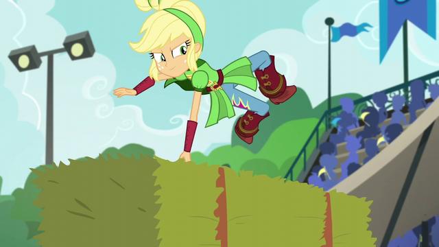 File:Applejack deftly leaps over a hay bale EG3.png