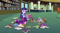 Twilight handling books with her hands EG