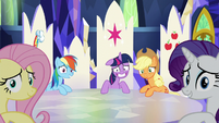 Twilight smiling nervously and others looking at Pinkie S5E11