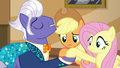 Gladmane takes AJ and Fluttershy by the hooves S6E20.png