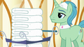 Spa Worker with cart of hot towels S6E10.png
