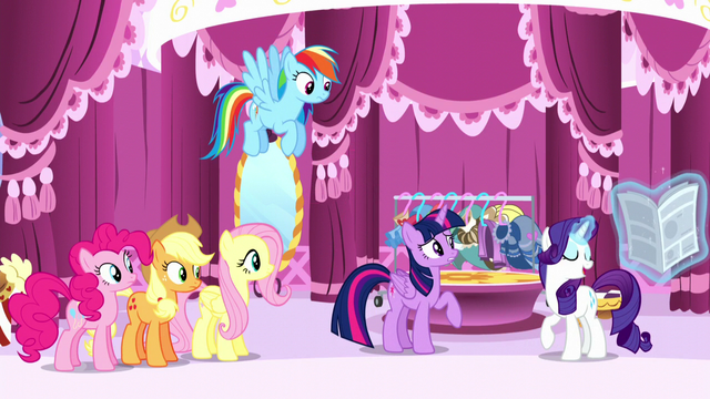 File:Rarity levitates the newspaper back to her S6E9.png