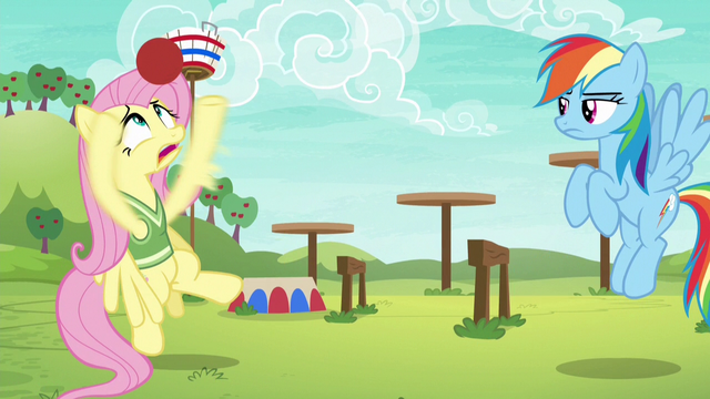 File:Fluttershy struggles to grab the softball S6E18.png