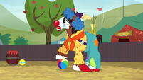 Trouble Shoes steps onto a beach ball S5E6