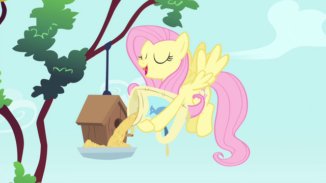 File:Fluttershy pouring birdseed S4E23.png