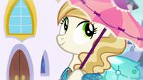 Pony wears a Princess Dress and holds a parasol S5E14