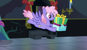 Rainbowshine flying with a present S6E8.png