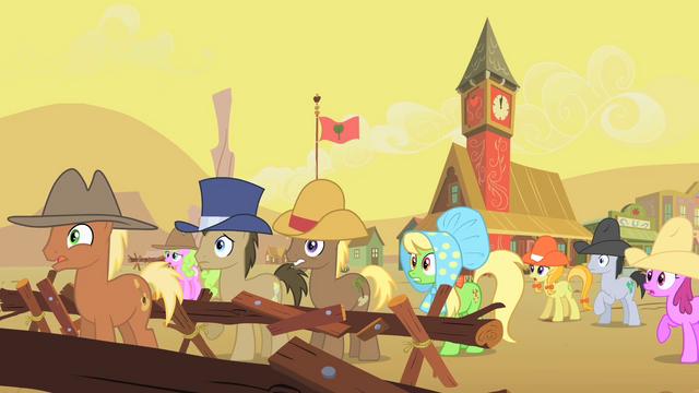 File:Appleloosa ponies watching buffalo gather S1E21.png