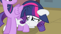 Rarity hides herself with Twilight's tail S4E13