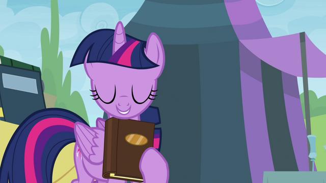 File:Twilight holding book close S4E22.png