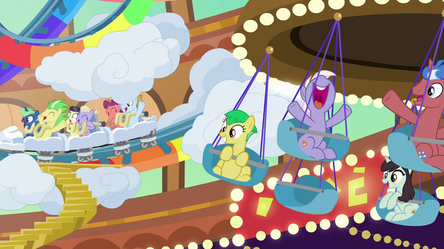 File:Ponies riding carnival rides in Gladmane's resort S6E20.png