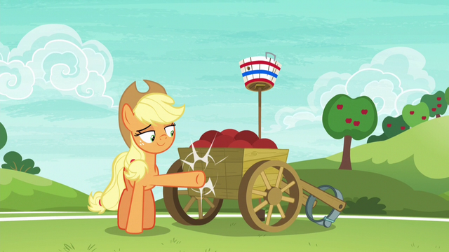 File:Applejack lightly kicking the ball cart S6E18.png