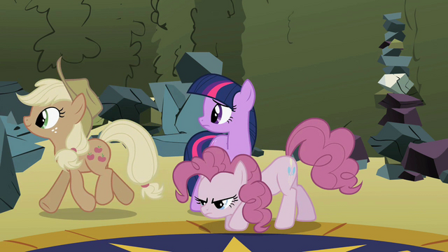 File:Applejack and Pinkie walking away S2E01.png