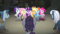 Mane six surrounded by the creepy ponies S5E1.png