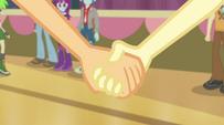 Applejack takes Fluttershy's hand EG2
