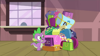 Spike grabbing a bag in the pile S4E8