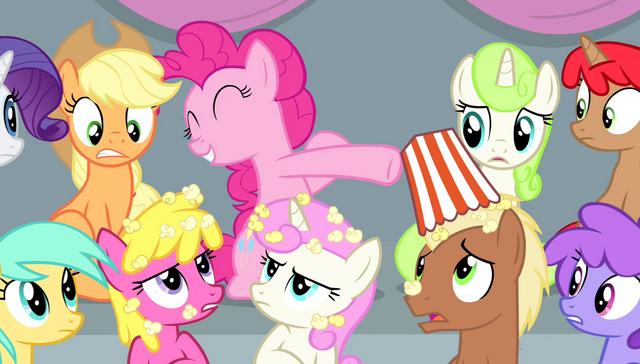 File:Pinkie spilling popcorn on other spectators S4E24.png