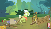 Granny Smith sticks her hoof on a piece of wood S4E09