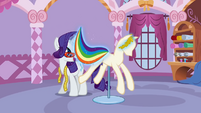 Rarity putting the rainbow-striped fabric on the mannequin S1E14
