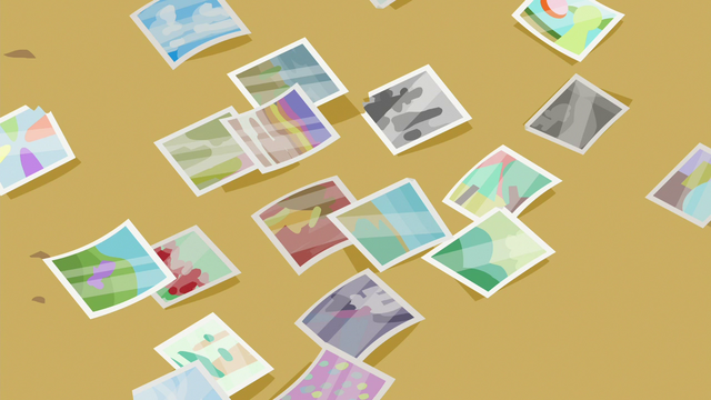 File:Photos scattered on the table S6E21.png