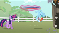 Twilight holds Rainbow Dash by the tail with her magic S2E03