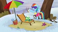 Rainbow putting sun tan lotion on top of Tank S5E5