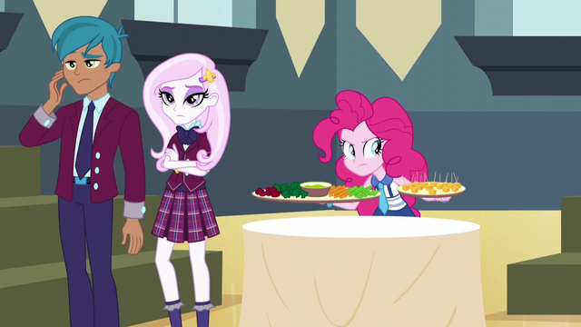 File:Pinkie covertly seizes the snack table trays EG3.png