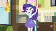 Rarity puts on a set of pony ears EG