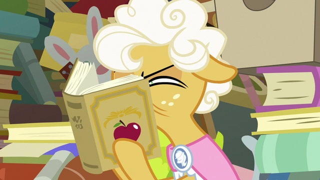 File:Goldie Delicious squinting at the book S7E13.png