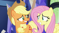 Applejack and Fluttershy grinning nervously S6E20.png