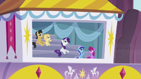 Rarity and other ponies watch the aerial display S5E15