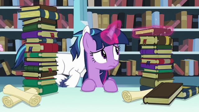 File:Twilight Sparkle levitates one of the books S6E2.png