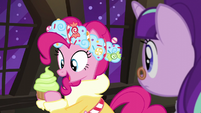 Spirit of HW Presents holding up cupcake S6E8