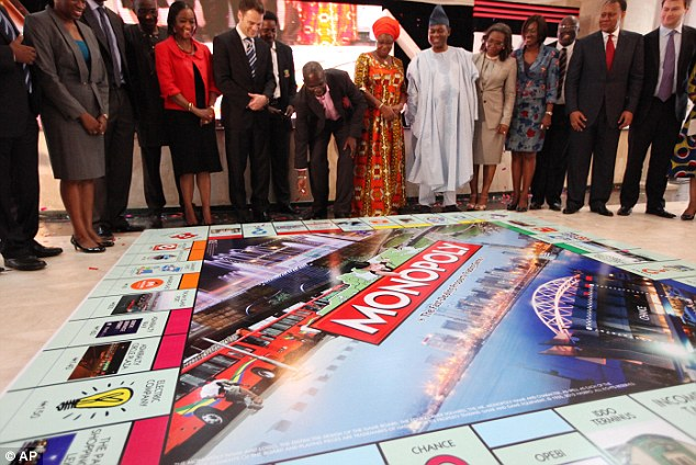 File:Lagos state governor, Babatunde Raji Fasholarolls (centre), rolls a dice during the presentation of the Lagos-themed Monopoly board game.jpg