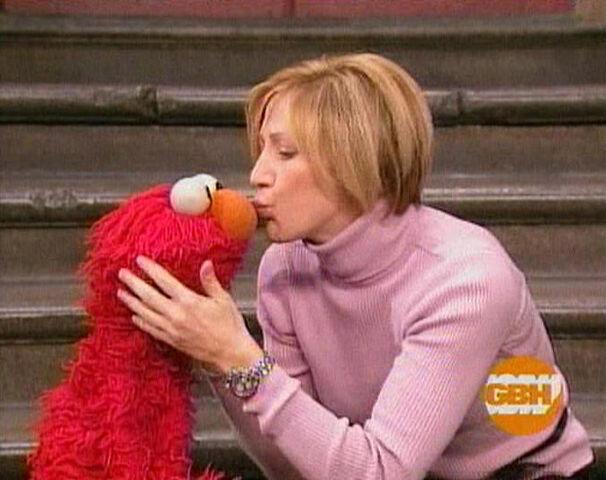 File:Kiss Elmo Edie Falco.jpg